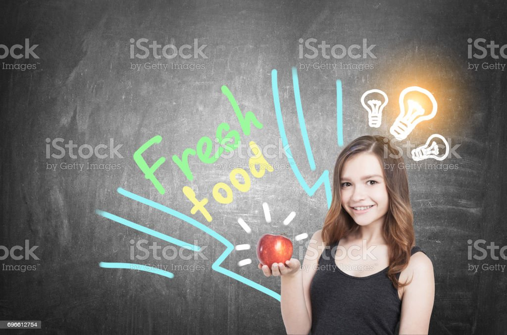 Girl with apple and food idea, blackboard stock photo