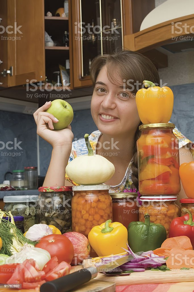 Girl with apple and vegetables royalty-free stock photo