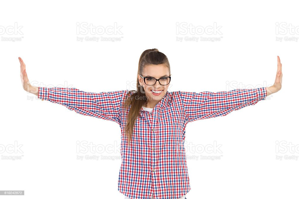 Girl With Arms Outstretched stock photo