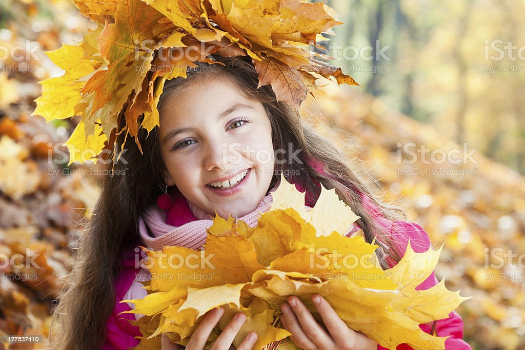 girl with autumn bouquet of maple leaves royalty-free stock photo
