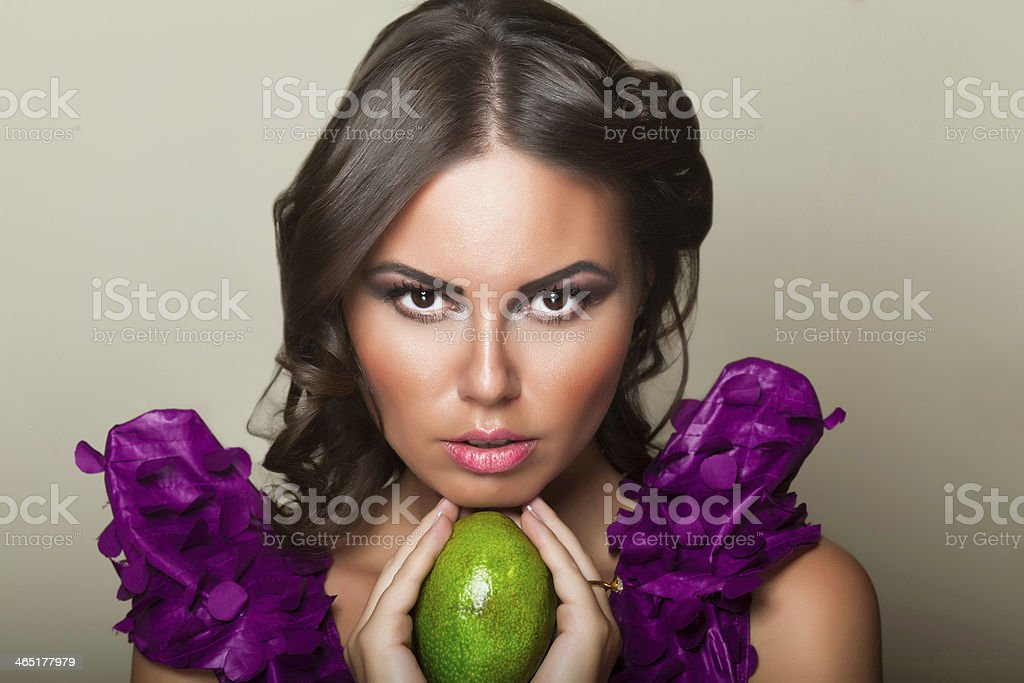 Girl with avocado royalty-free stock photo