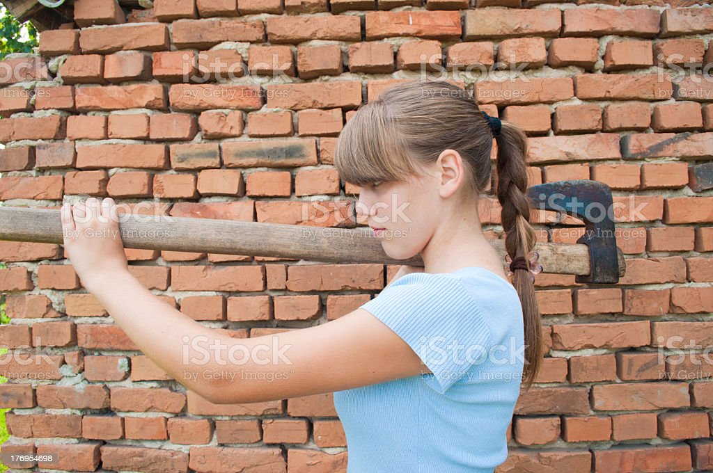 Girl with axe royalty-free stock photo