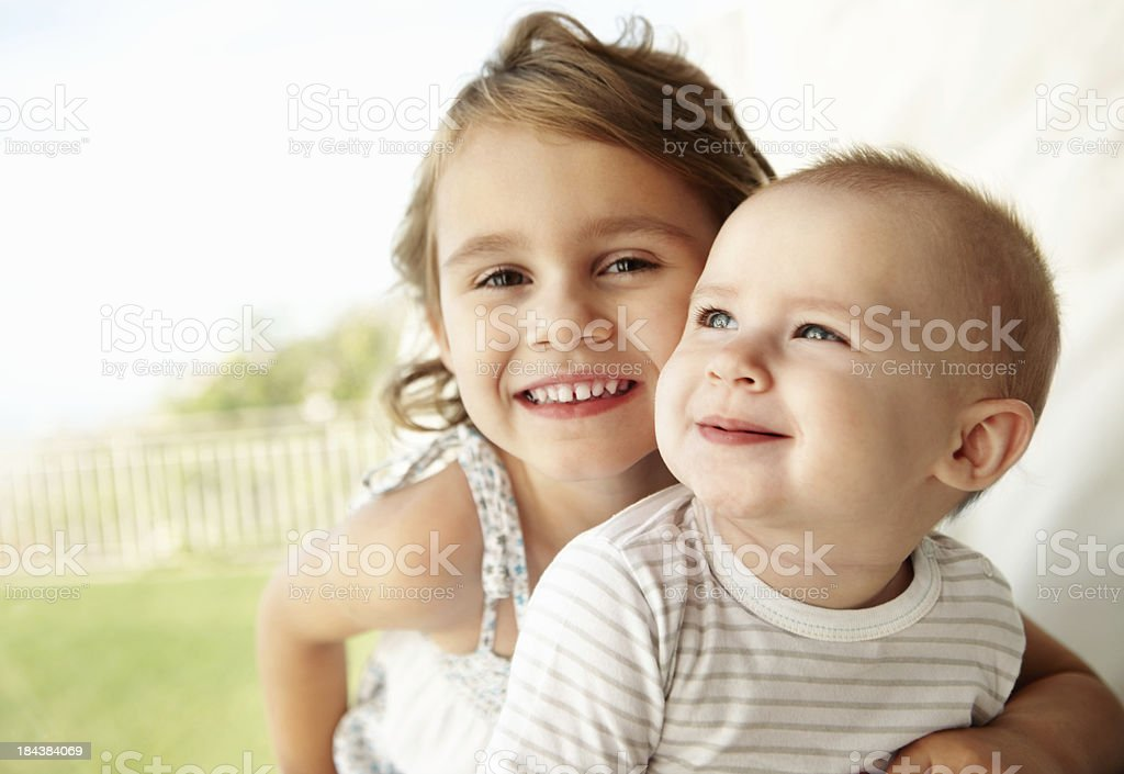 Girl with baby sister royalty-free stock photo