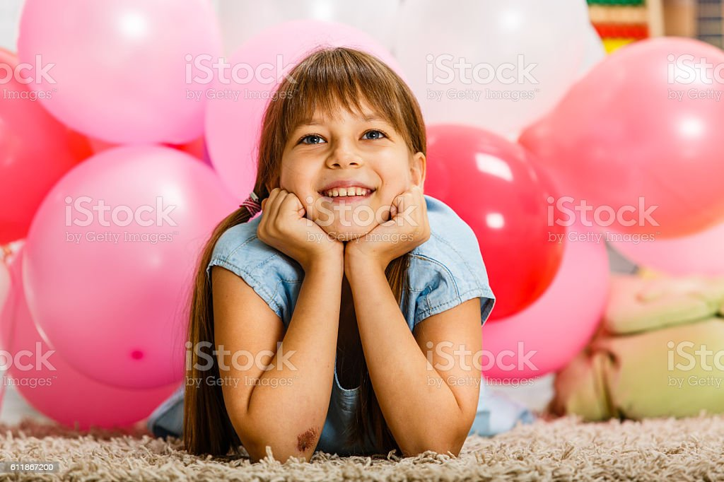 Girl with balloons in her room stock photo