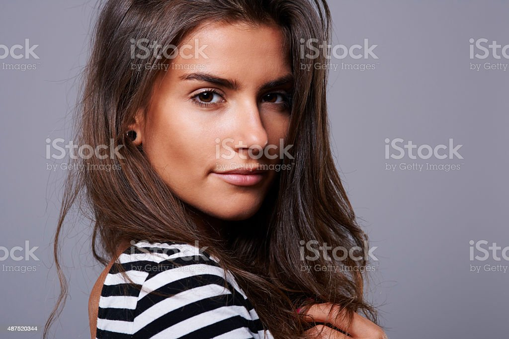 Girl with big brown and hypnotising eyes stock photo