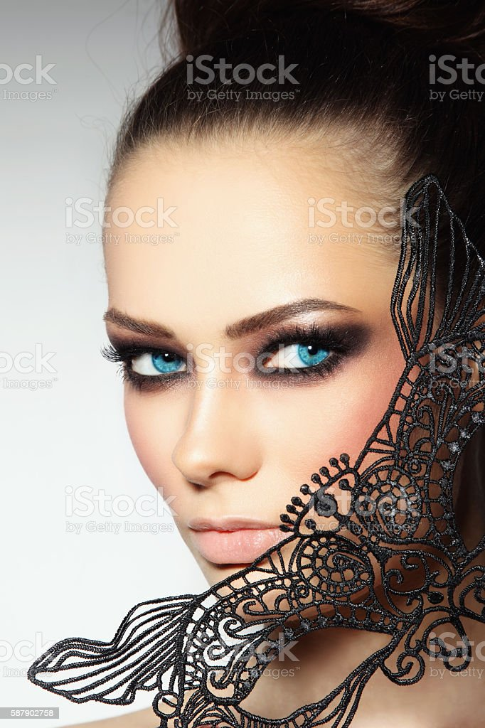 Girl with black mask stock photo