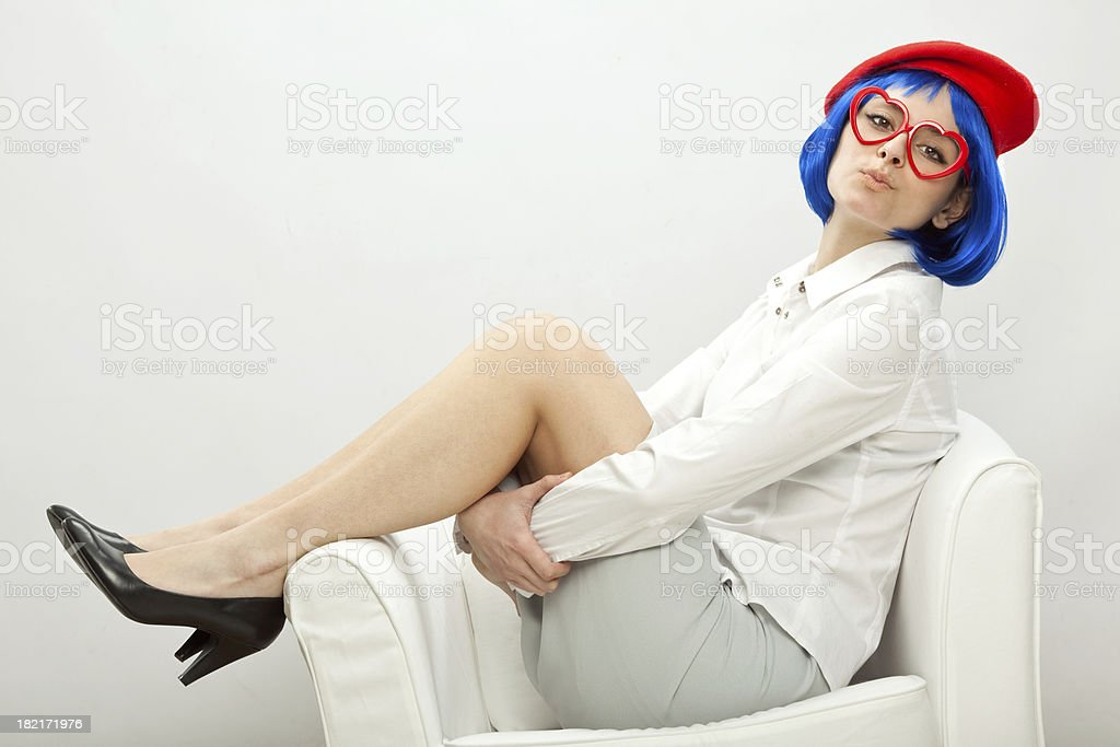 girl with blue wig and red glasses stock photo