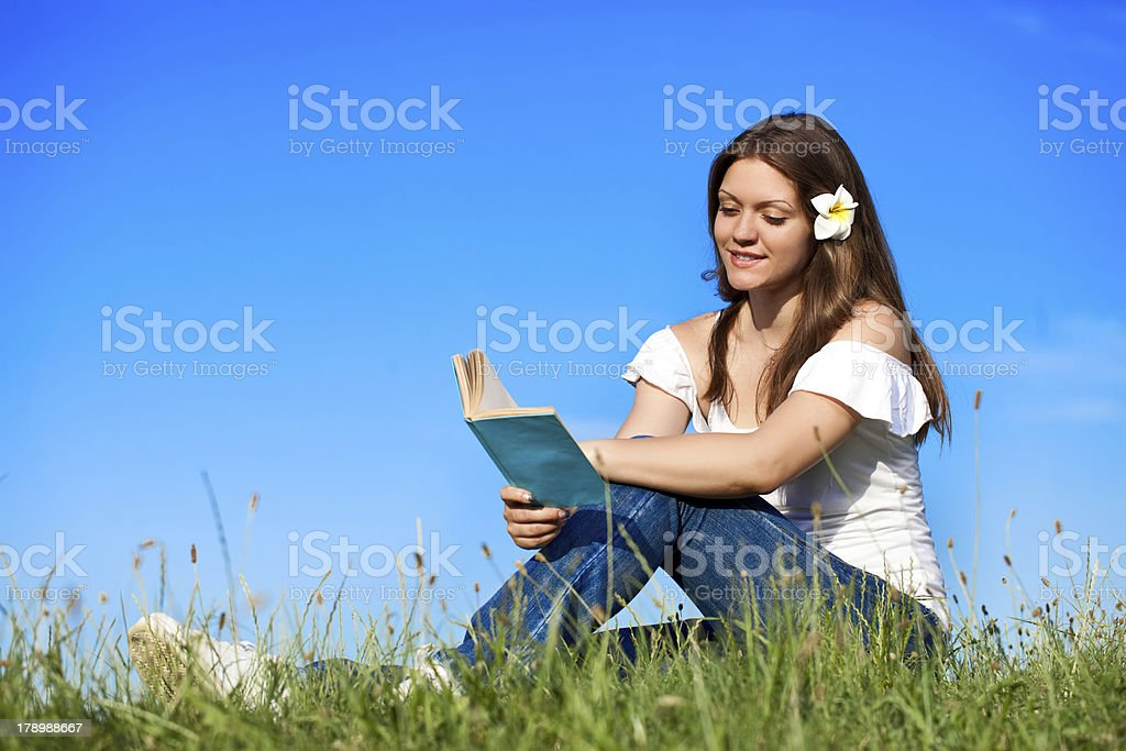 Girl with book enjoying in summer royalty-free stock photo