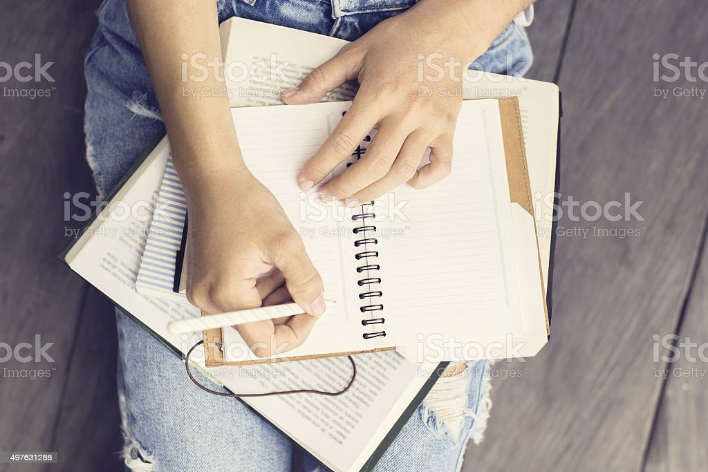 Girl with books and a diary stock photo