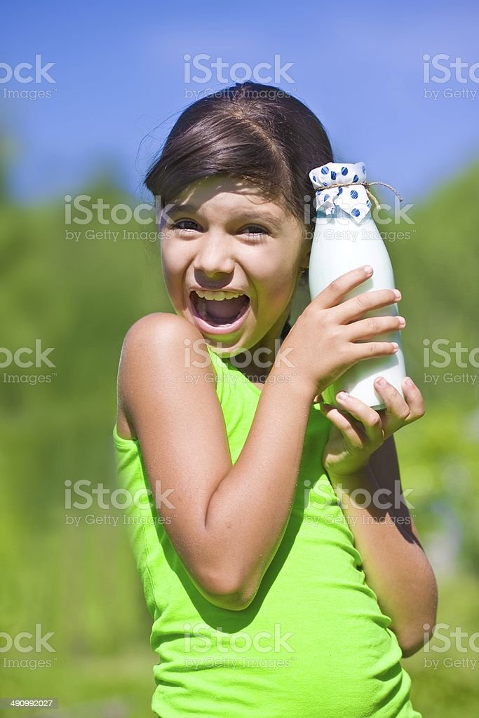 girl with bottle of milk royalty-free stock photo