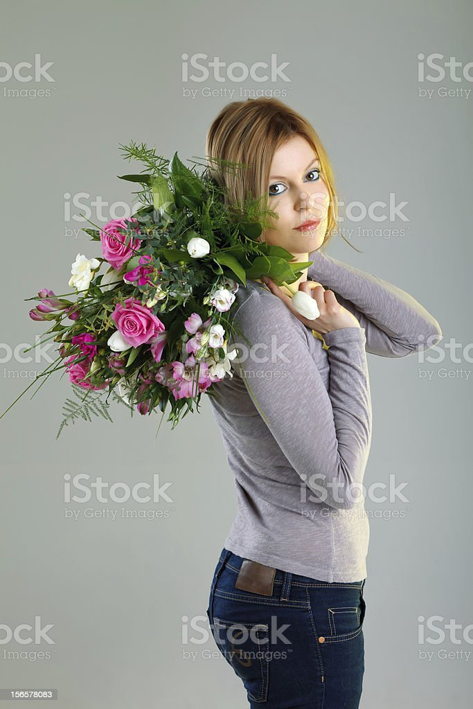 Girl with bouquet of flowers royalty-free stock photo