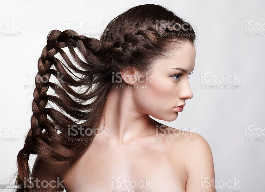 A girl with brown hair in waterfall braids royalty-free stock photo