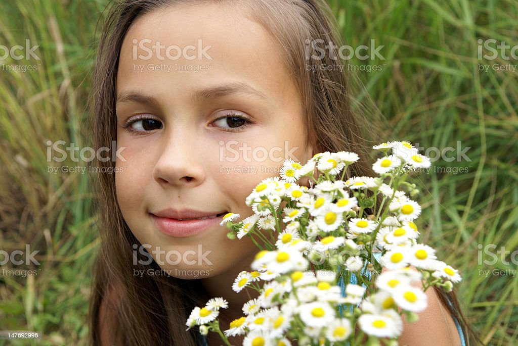 Girl with bunch of field flowers royalty-free stock photo