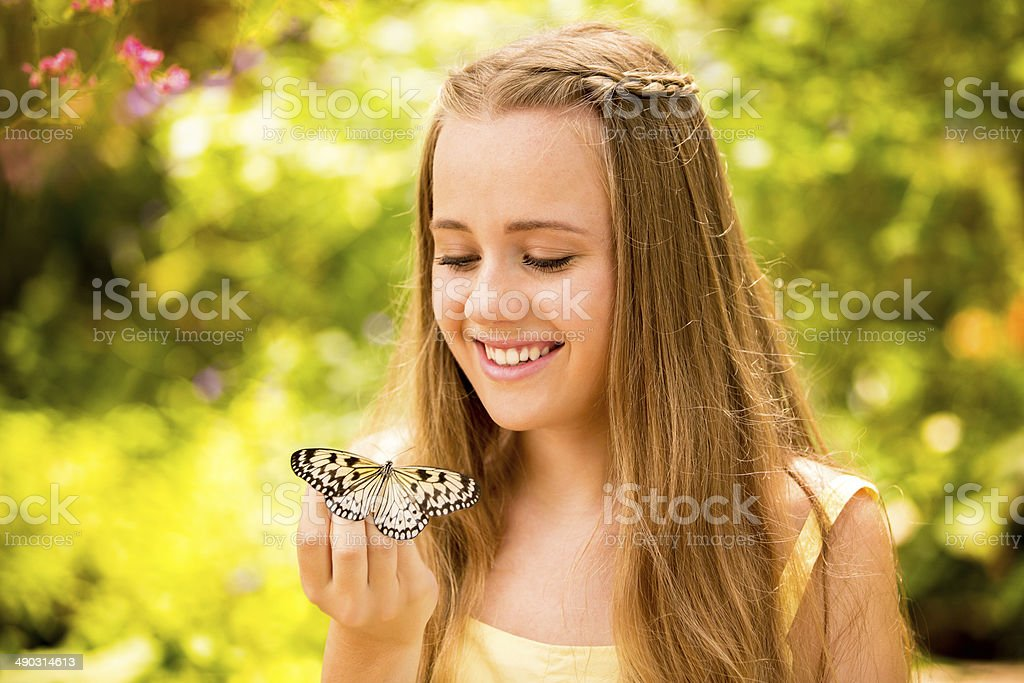 Girl with butterfly, close up stock photo