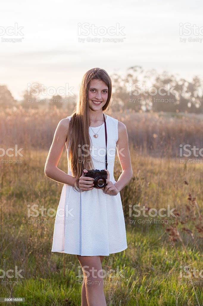 Girl with camera stock photo