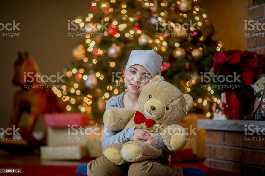 Girl with Cancer Holding Her Teddy Bear stock photo
