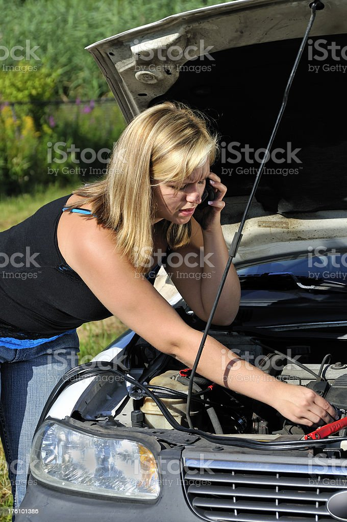 Girl with Car Trouble Calling for Service royalty-free stock photo