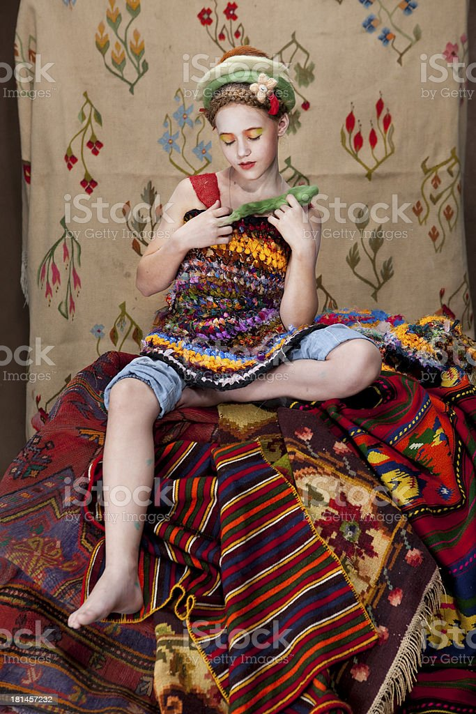 girl with carpets 2 royalty-free stock photo