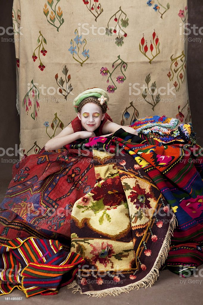girl with carpets 4 royalty-free stock photo