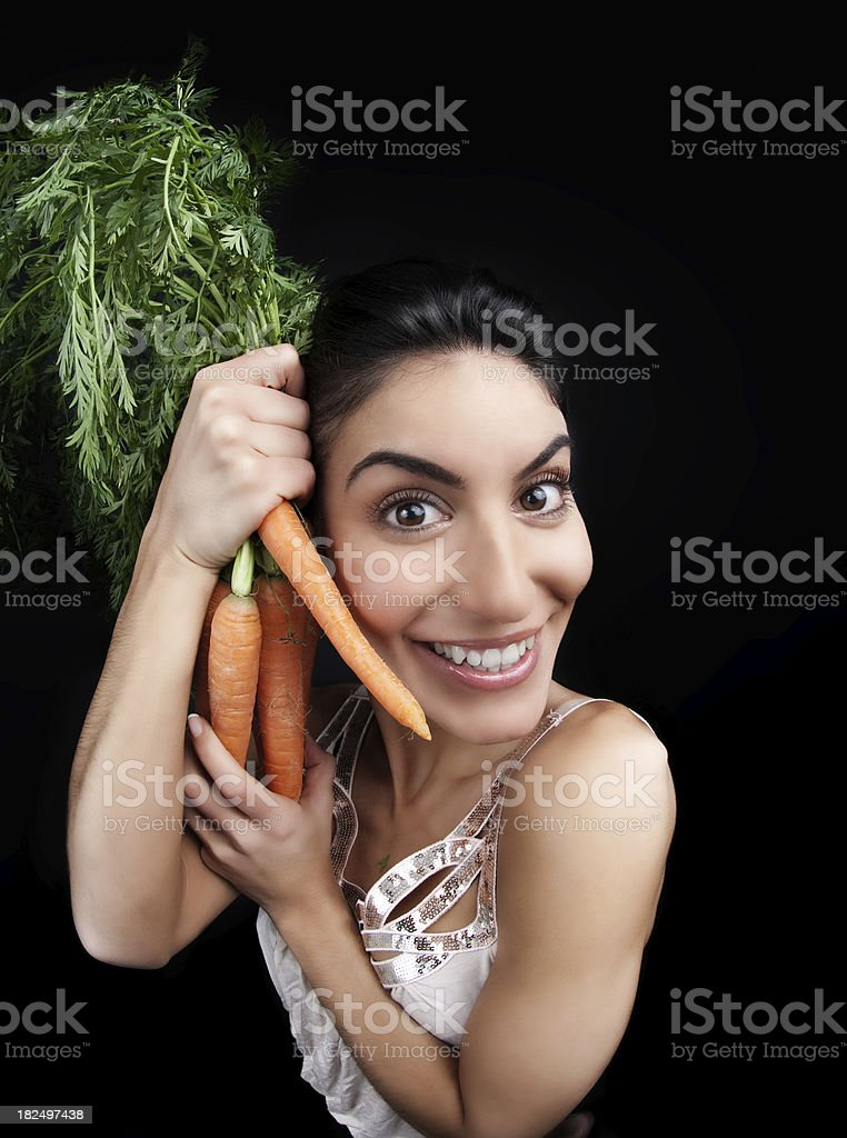 Girl with carrot royalty-free stock photo