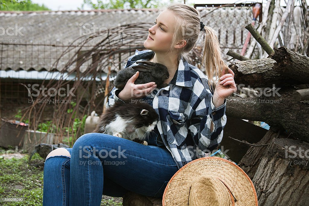 girl with cat and rabbit stock photo