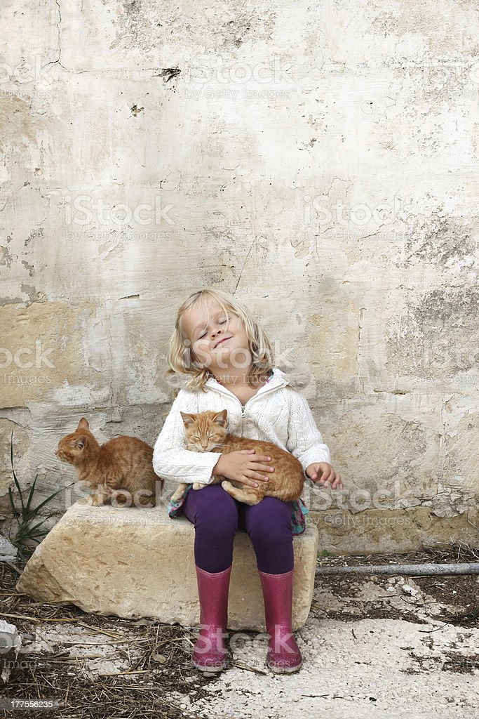 Girl with cats royalty-free stock photo