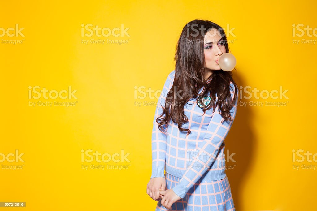 girl with chewing gum posing in the Studio stock photo