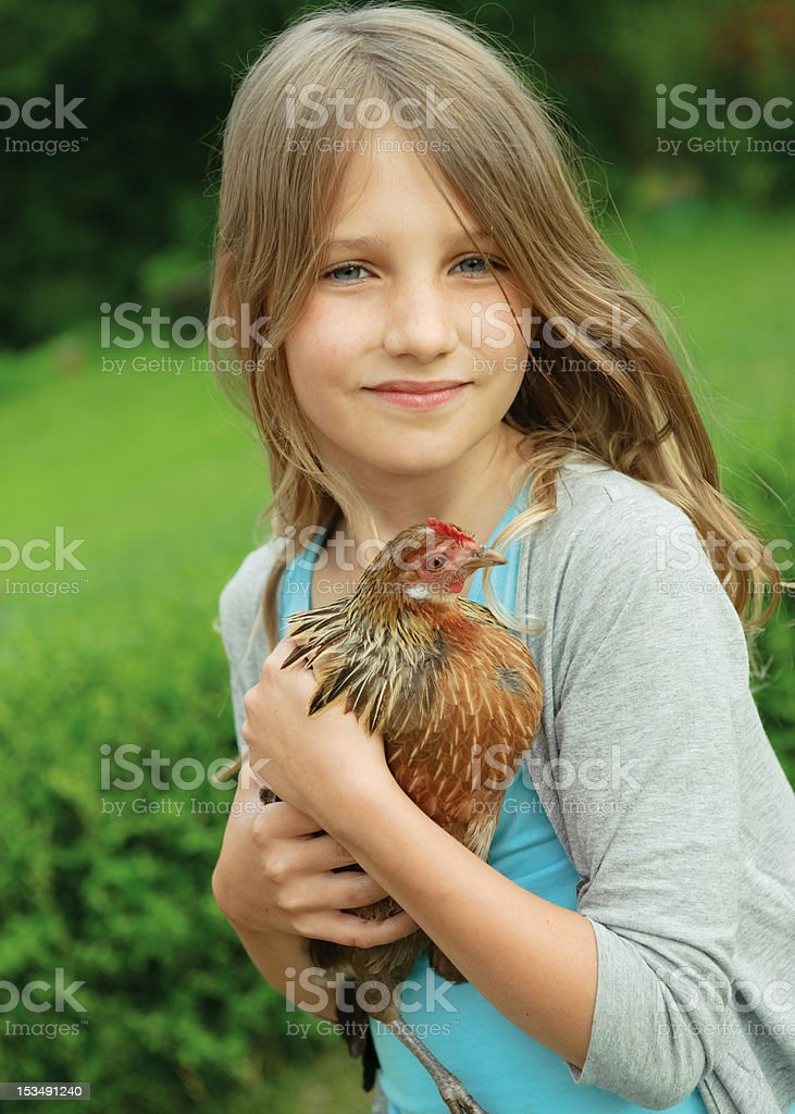 Girl with chicken royalty-free stock photo