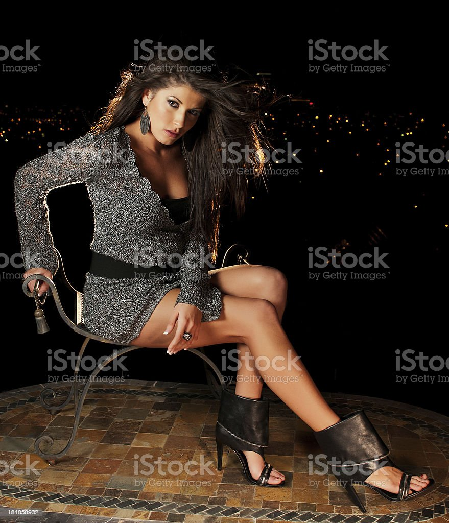 Girl with city lights in background stock photo