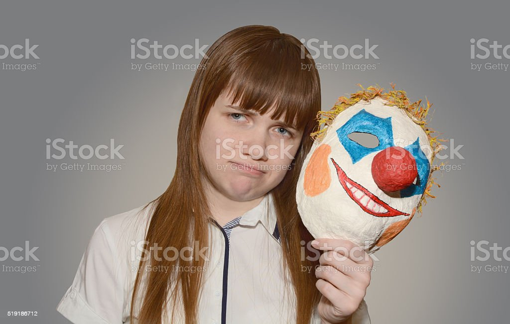 Girl with clown mask stock photo