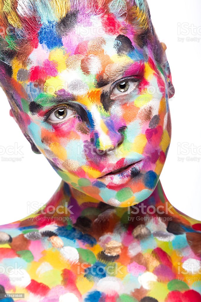 Girl with colored face painted. Art beauty image stock photo