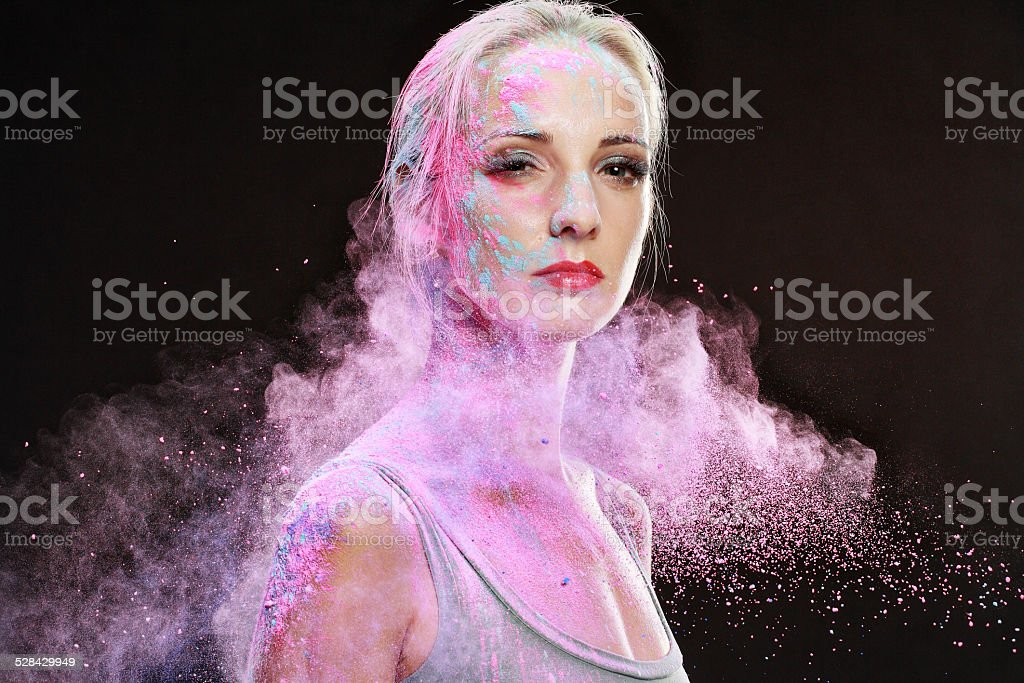 girl with colored powder stock photo