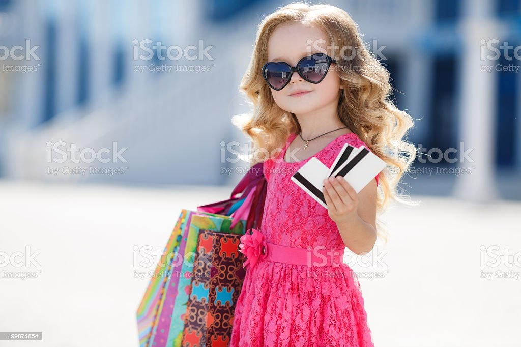Girl with colorful bags and credit card stock photo