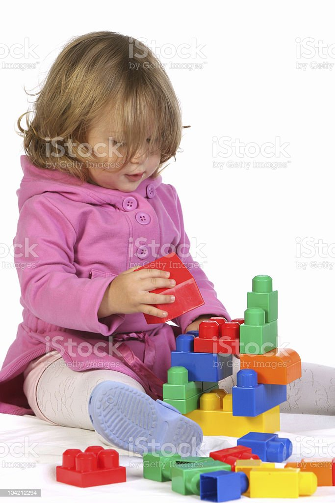 girl with colorful blocks stock photo