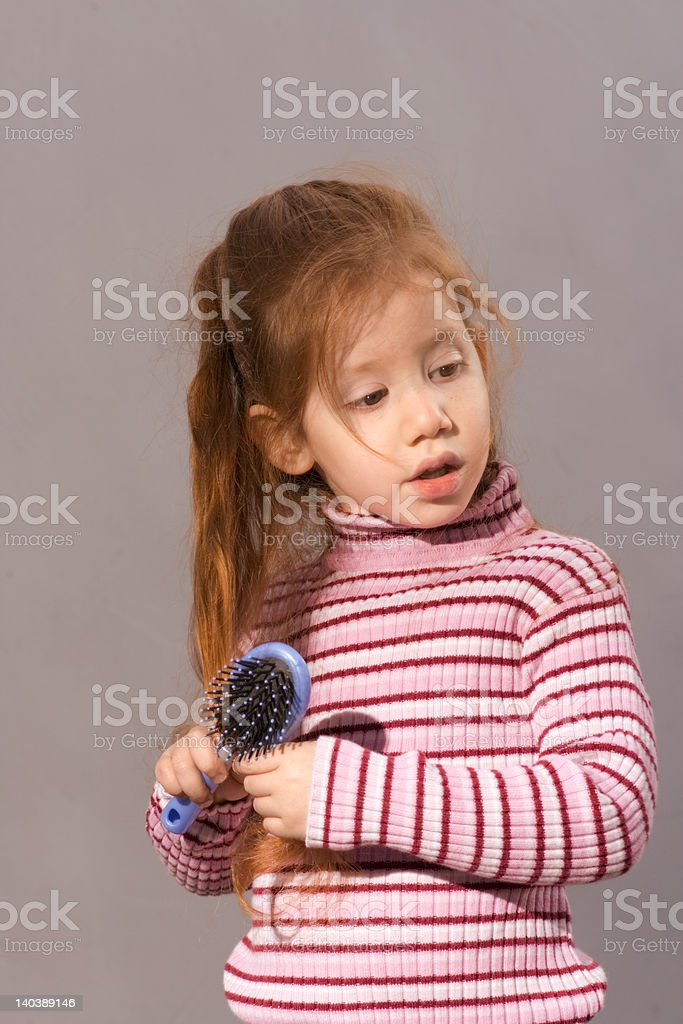 Girl with comb royalty-free stock photo