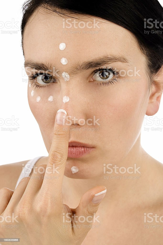 Girl with cream on her face stock photo