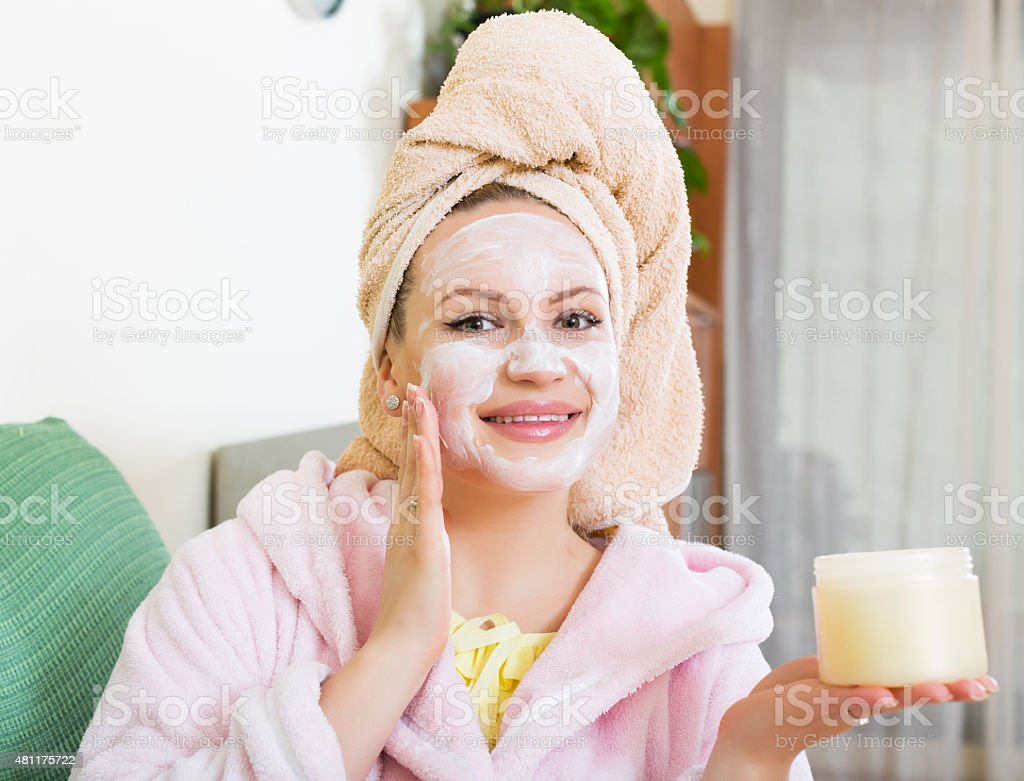Girl with cream over face stock photo
