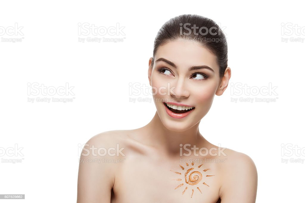 Girl with cream sun shape drawing on chest stock photo