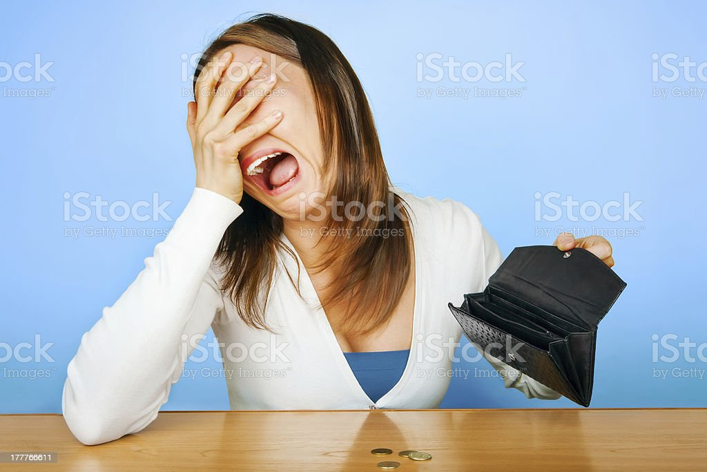 Girl with crying face with empty wallet stock photo