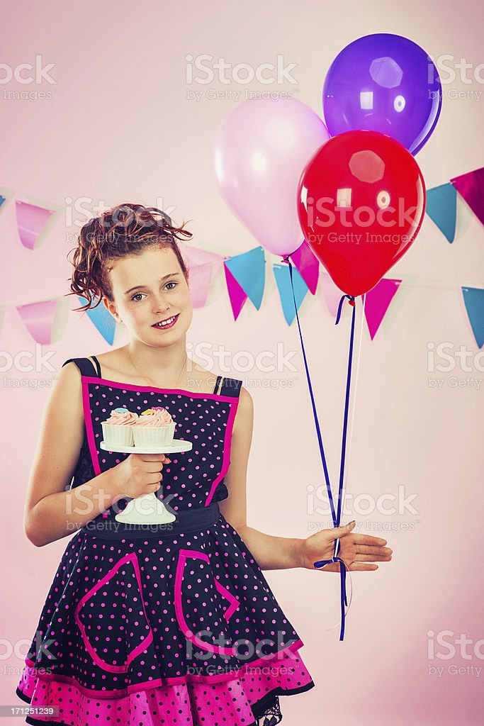 Girl with cupcakes and balloons royalty-free stock photo