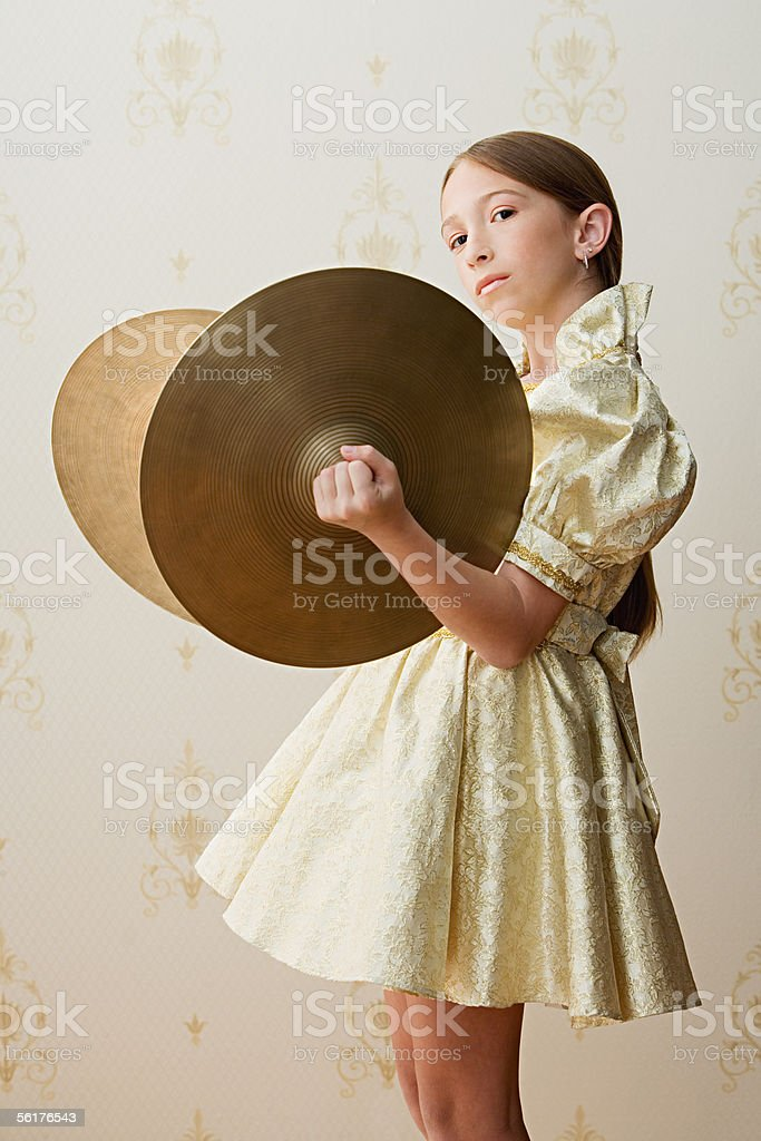 Girl with cymbals stock photo