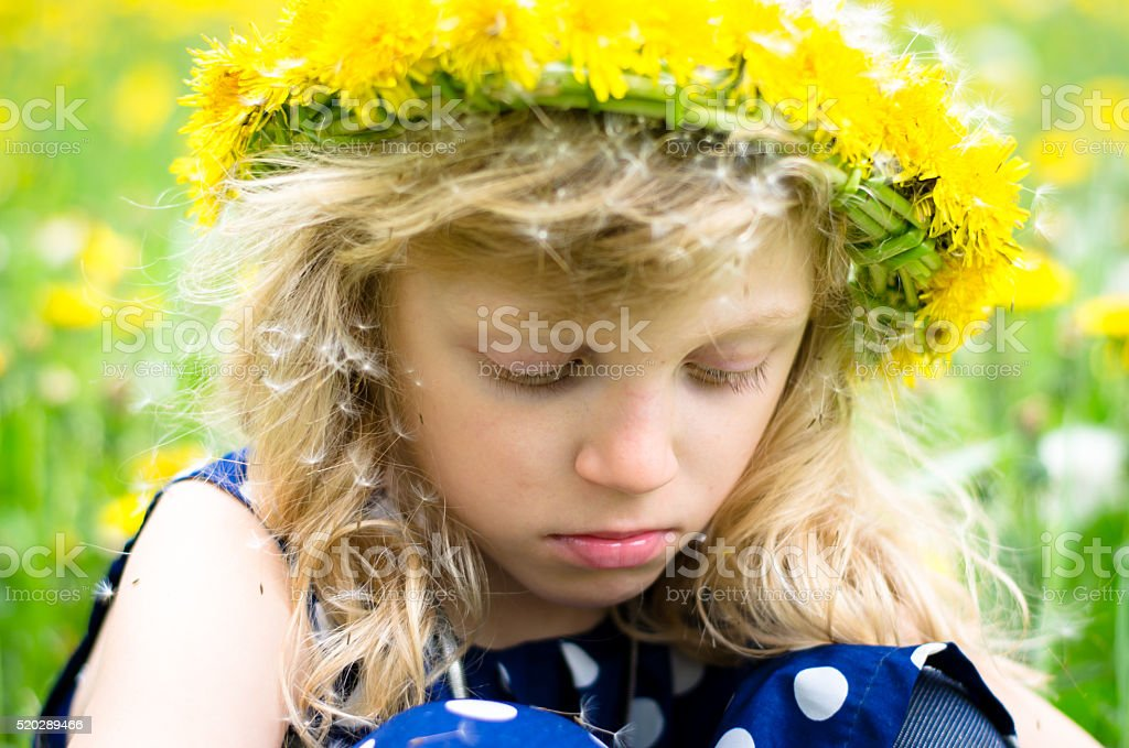 girl with dandelion chain stock photo