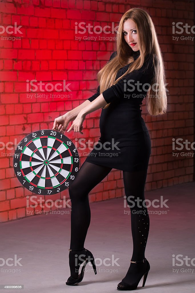 Girl with darts stock photo