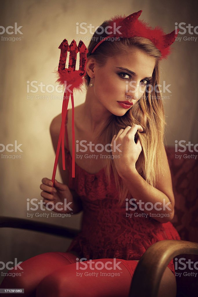 girl with devil's horn and fork royalty-free stock photo