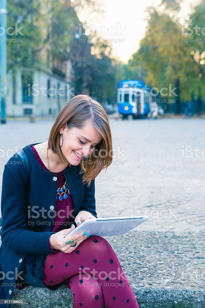 Girl with  digital tablet in the city stock photo