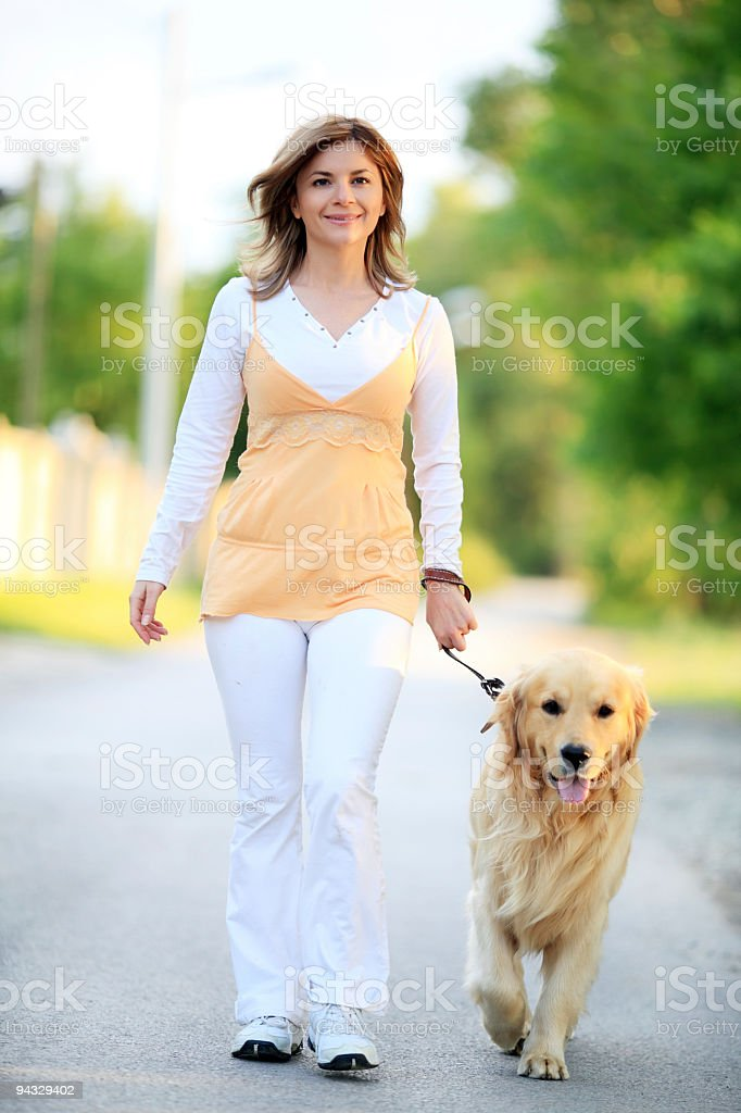 Girl with dog strolling outdoor. royalty-free stock photo