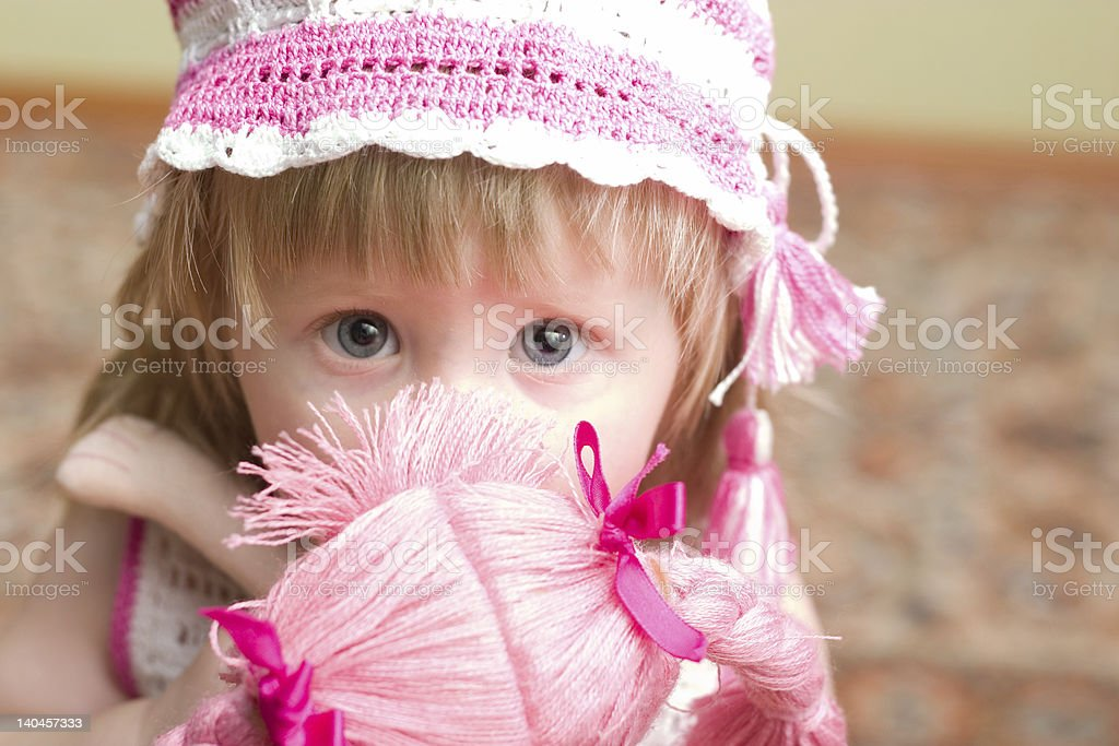 girl with doll royalty-free stock photo
