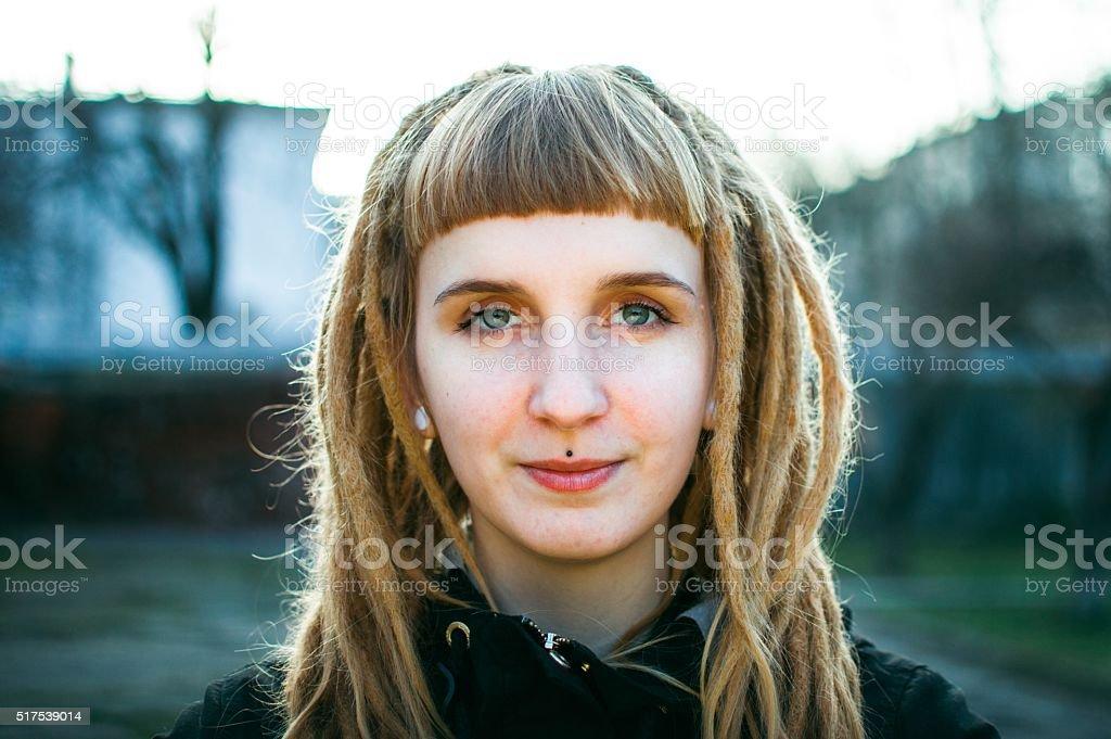 Girl with dreadlocks stock photo