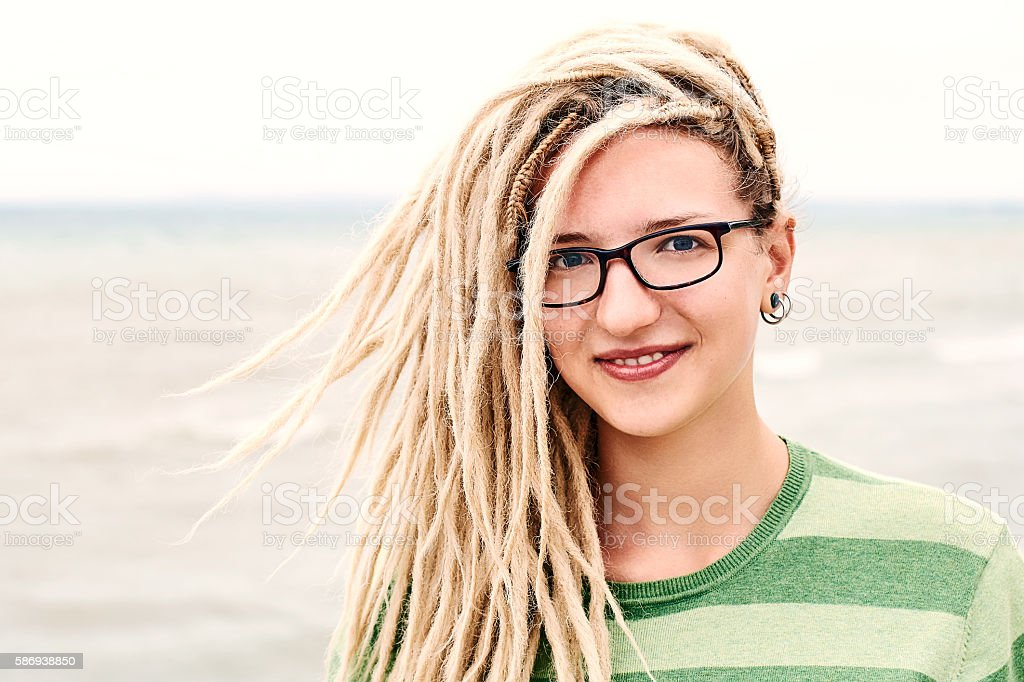 Girl with dreads and sea stock photo