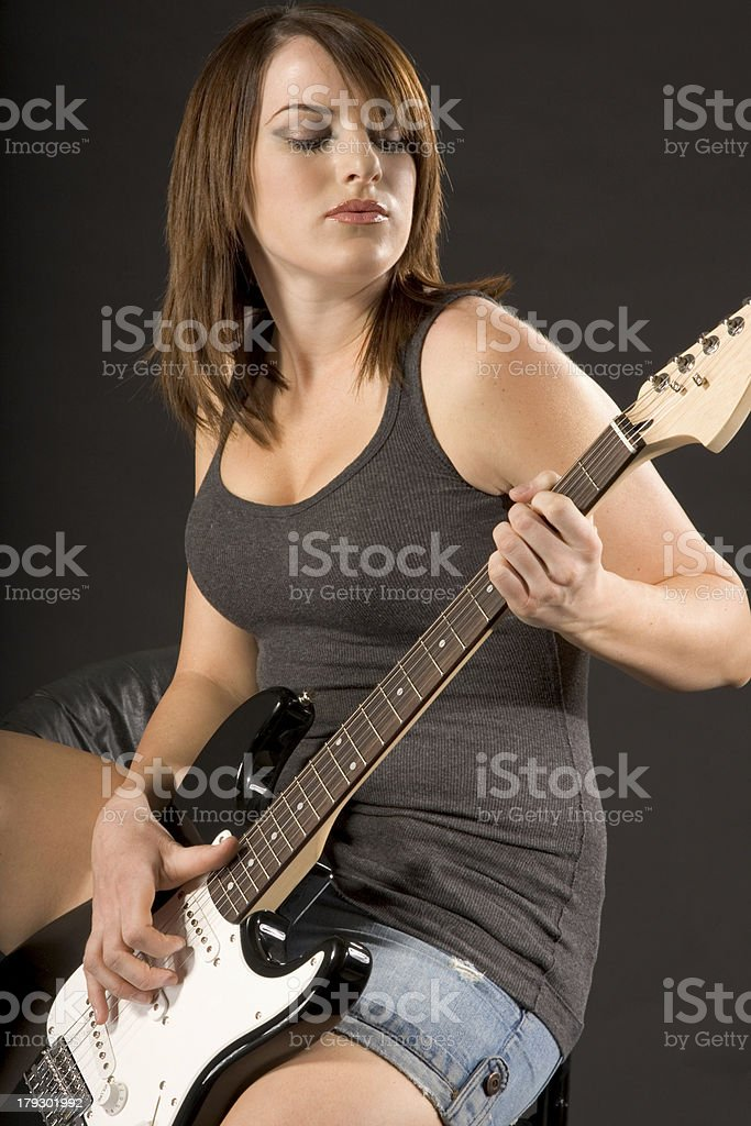 Girl with electric guitar royalty-free stock photo